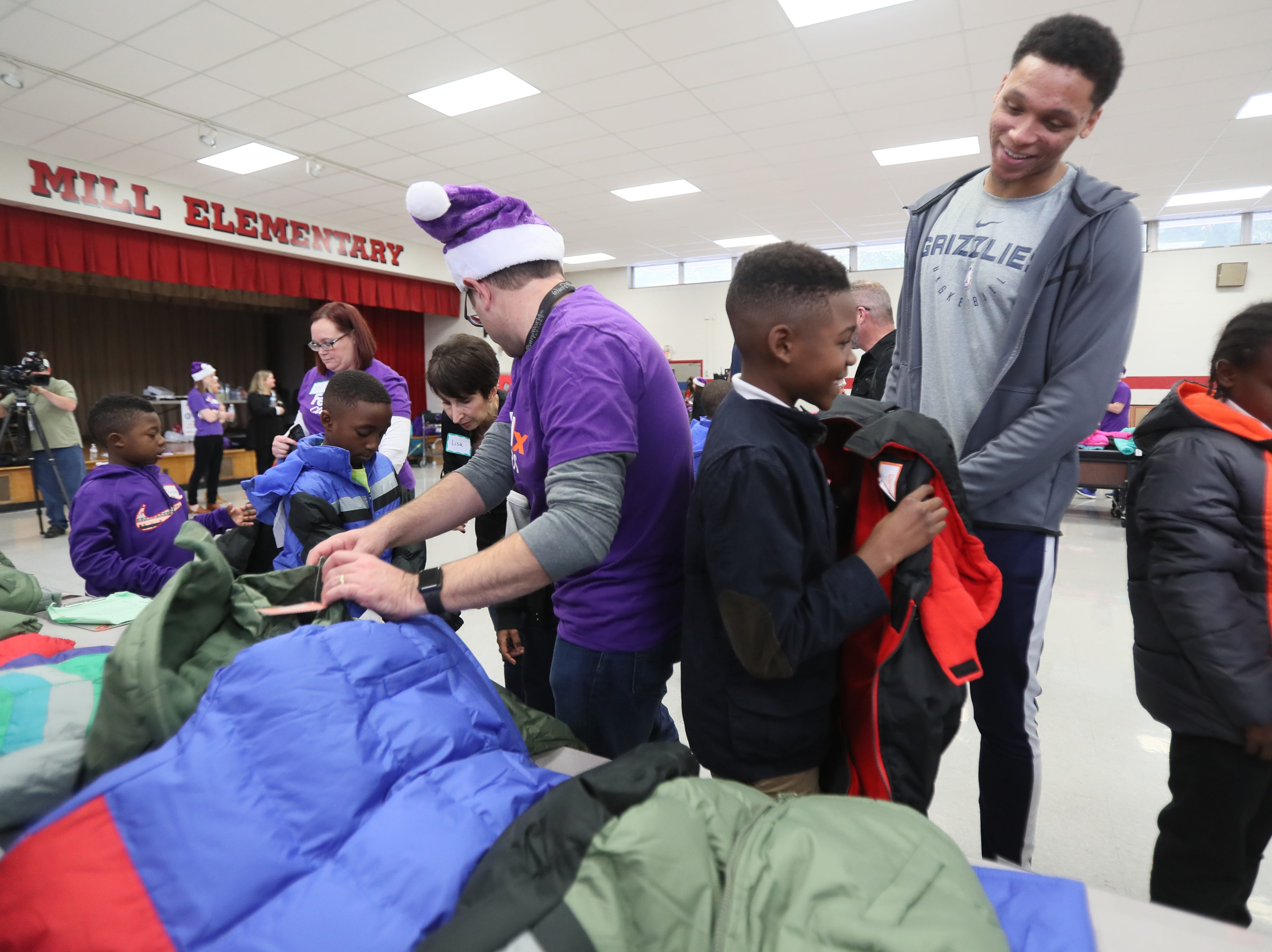Memphis Grizzlies forward Ivan Rabb joins FedEx and Operation Warm to help surprise children with new coats at Hawkins Mill Elementary School on Thursday, Nov. 8, 2018.