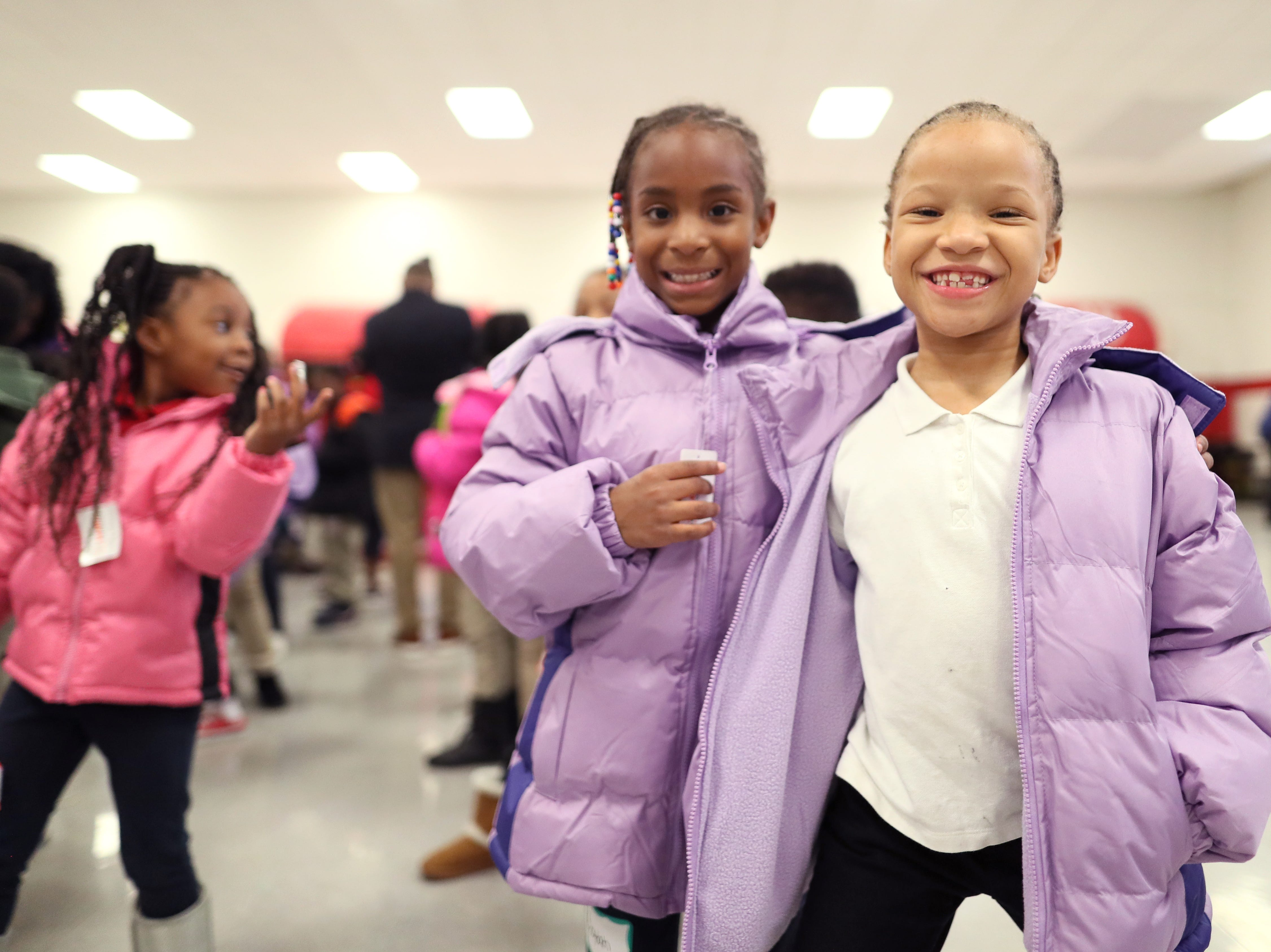 Fa'Lencia Neal, 7, right, and Keylah Price, 7, sport their new winter wear as FedEx, the Memphis Grizzlies and Operation Warm surprised children with new coats at Hawkins Mill Elementary School on Thursday, Nov. 8, 2018.