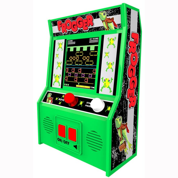 Sarah Fowles, co-owner of Ruckus and Glee in Wauwatosa, is excited that hand-held arcade games, like Frogger, are back in style.