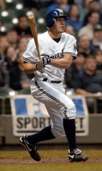 Milwaukee Brewers' Scott Podsednik hits a home run in the first inning against the San Diego Padres Monday, May 19, 2003, in Milwaukee.