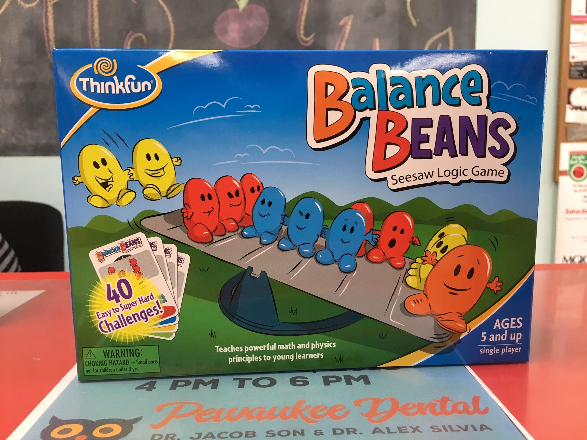 Think Fun games live up to their name by teaching kids as they have fun. Silly Willyz in Pewaukee sells them, including Balance Beans, where players learn about balancing equations by placing different-colored beans on different sides of a seesaw.