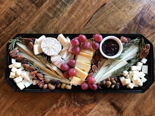 This long and elegant platter is filled with contrasts: soft, silky surface-ripened cheese, firm, aged cheeses, and varieties made from both sheep and cow's milk.