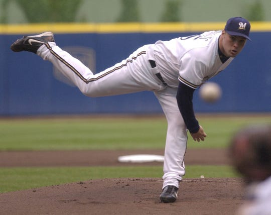 Milwaukee Brewer pitcher Ben Sheets fires a pitch against the Minnesota Twins Friday, June 18, 2004.