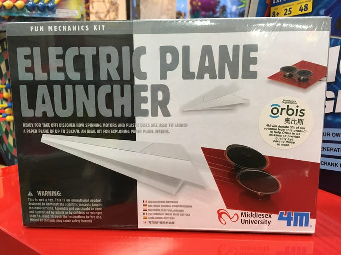 Sarah Fowles, co-owner of Ruckus and Glee in Wauwatosa, says an educational toy will get used if it's fun. Like this electric plane launcher.