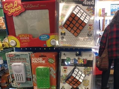 Sarah Ditzenberger, owner of Fischberger's Variety, specializes in inexpensive novelties, including nostalgic items like Etch-a-Sketch and Rubix Cubes.