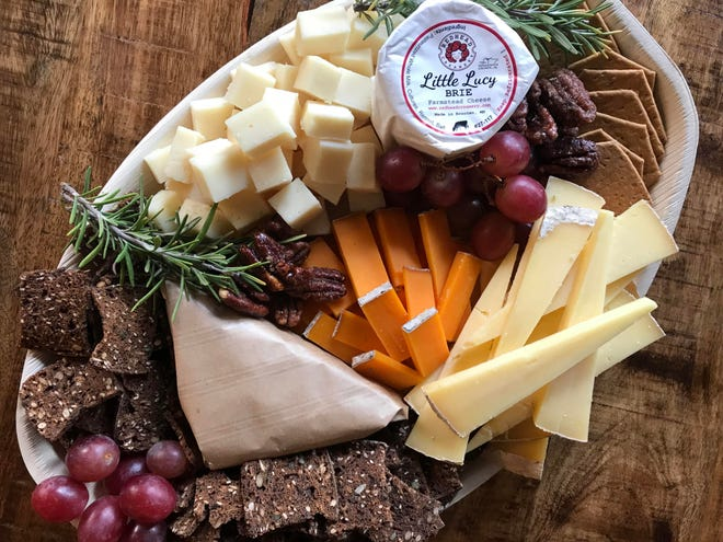This board has vividly colored Red Rock from Roelli's in the center, along with Little Lucy brie from Redhead Creamery and Potter's Crackers caramelized onion crisps.