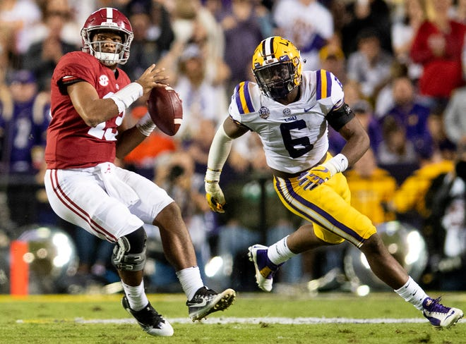 Alabama quarterback Tua Tagovailoa (13) throws the ball against Louisiana State University linebacker Jacob Phillips (6) in first half action at Tiger Stadium in Baton Rouge, La., on Saturday November 3, 2018.