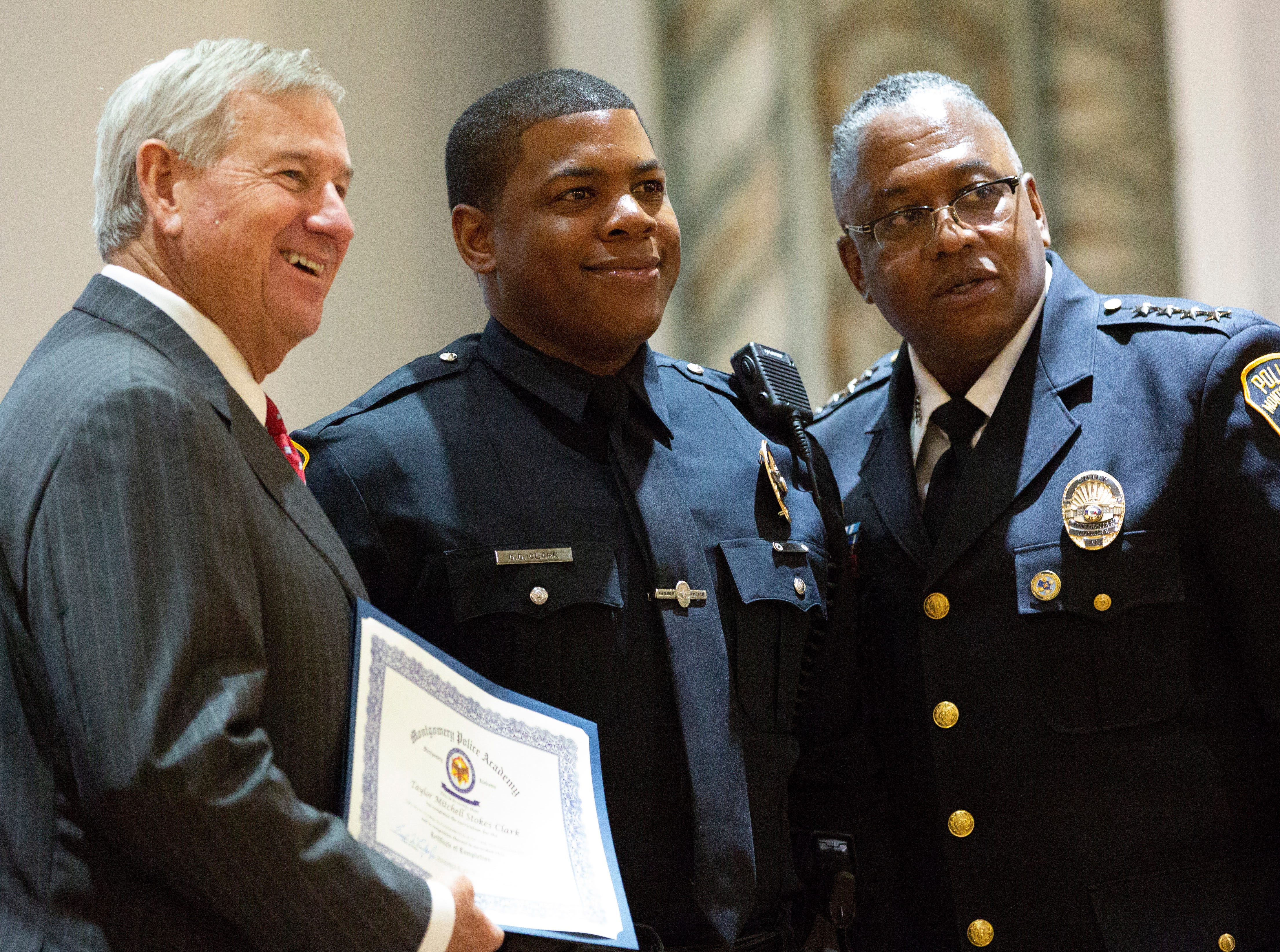 Montgomery police officer Dontavious Clark poses for a photo after graduating from the academy.