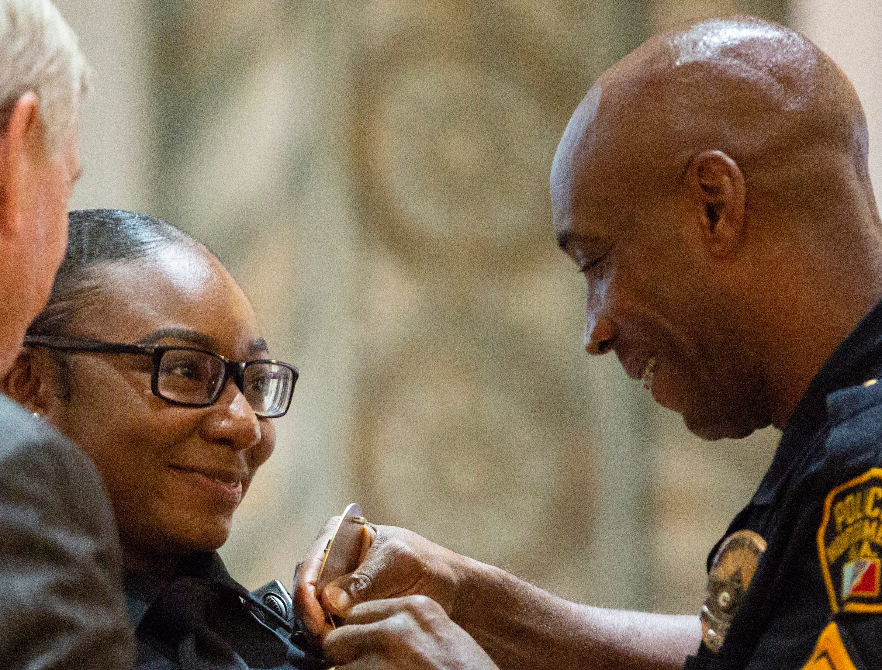 Montgomery police officer Kelsey Mackey smiles with pride as her badge is pinned on her.