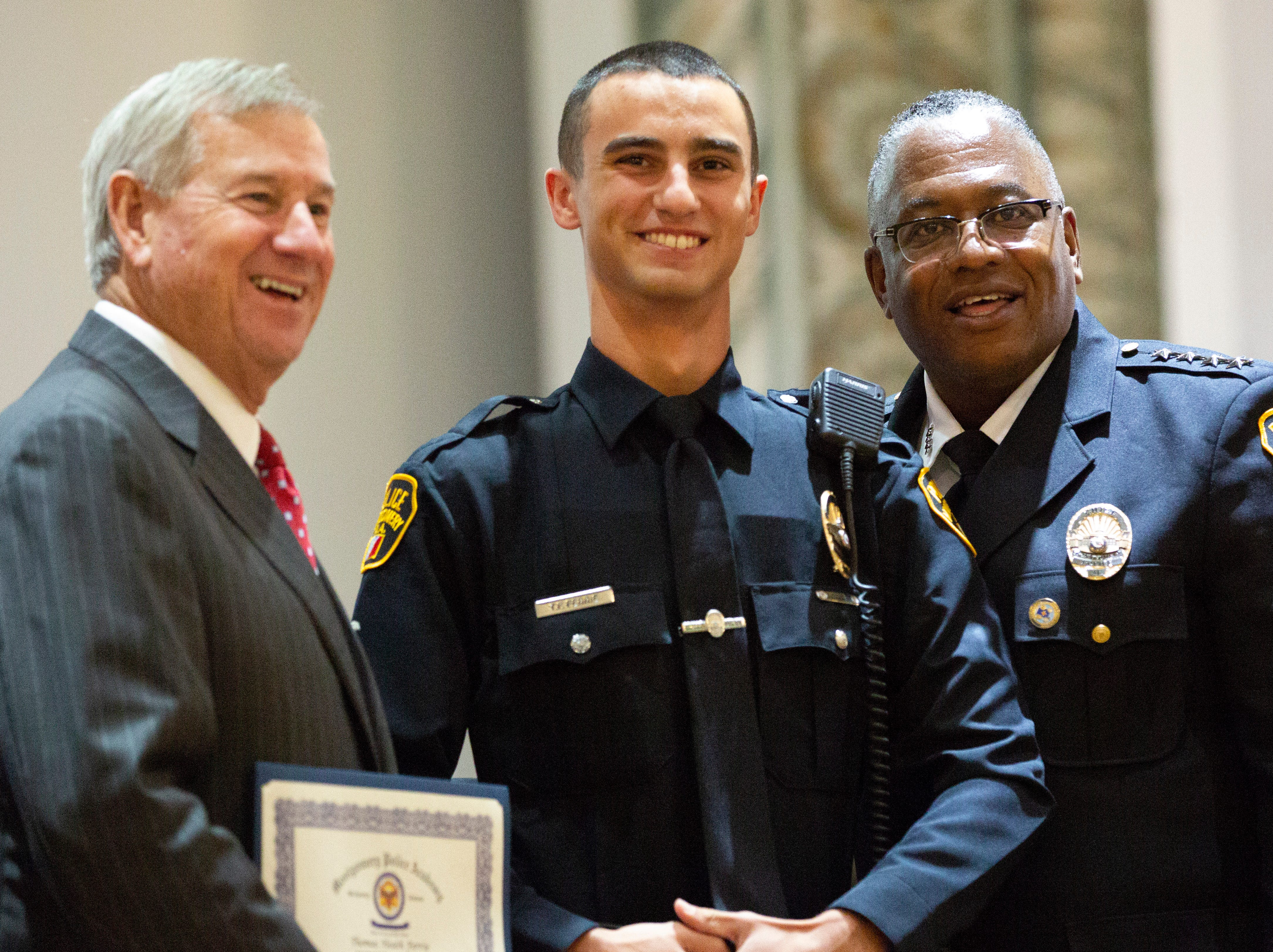 Montgomery police officer Thomas Ferrie  poses for a photo after graduating from the academy.
