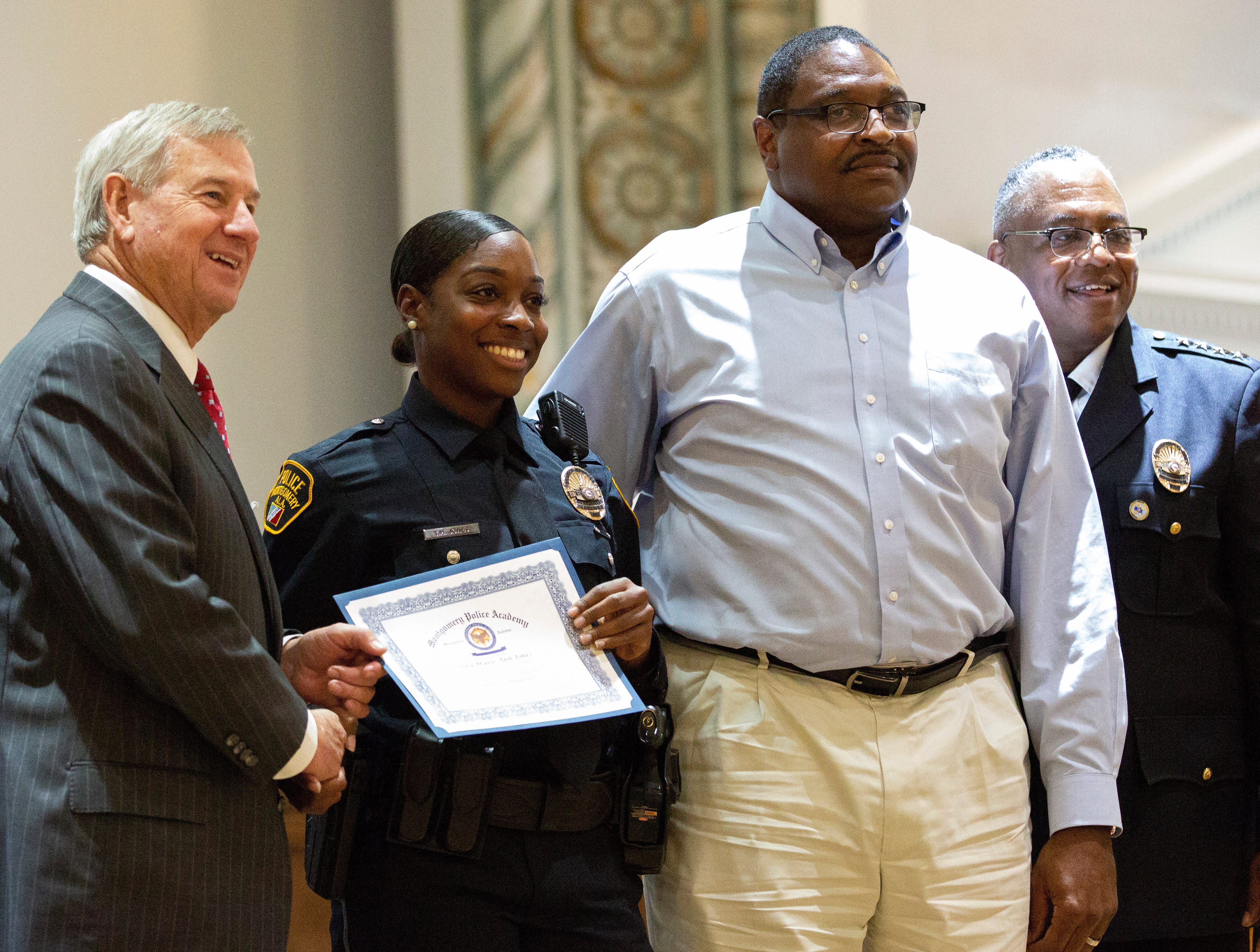 Montgomery police officer Tina Marie Jones poses for a photo after graduating from the academy.