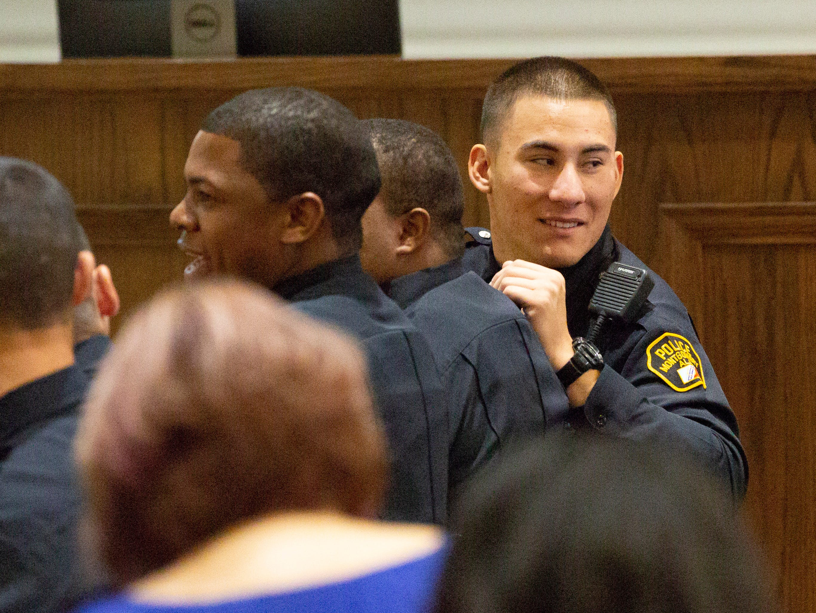 Montgomery police officer Donovan Boone chats with his fellow graduates before a ceremony at City Hall.