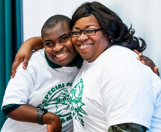 Mary Bradley hugs her son Joseph Bradley on Thursday November 8, 2018 at Jeff Davis High School in Montgomery, Ala. Joseph has been chosen to be on the Special Olympics equestrian team competing at the Special Olympics World Games in Abu Dhabi next year.