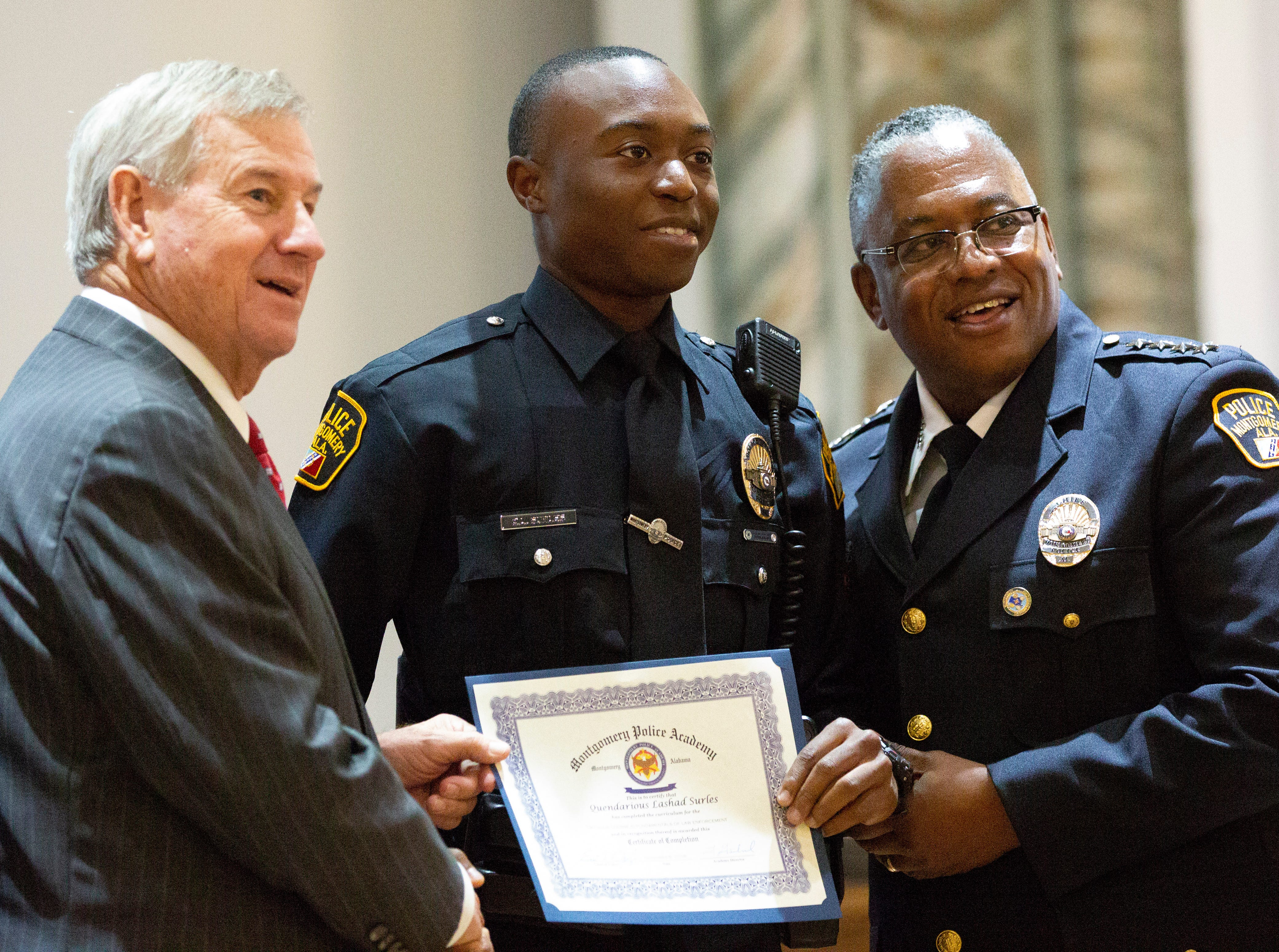 Montgomery police officer Quendarious Surles poses for a photo after graduating from the academy.