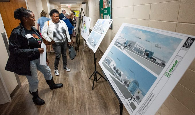 Parents look at architectural drawing of One Place during a Community Charrette held to discuss BTW Magnet School plans on Thursday November 8, 2018 at Aldersgate United Methodist Church in Montgomery, Ala.
