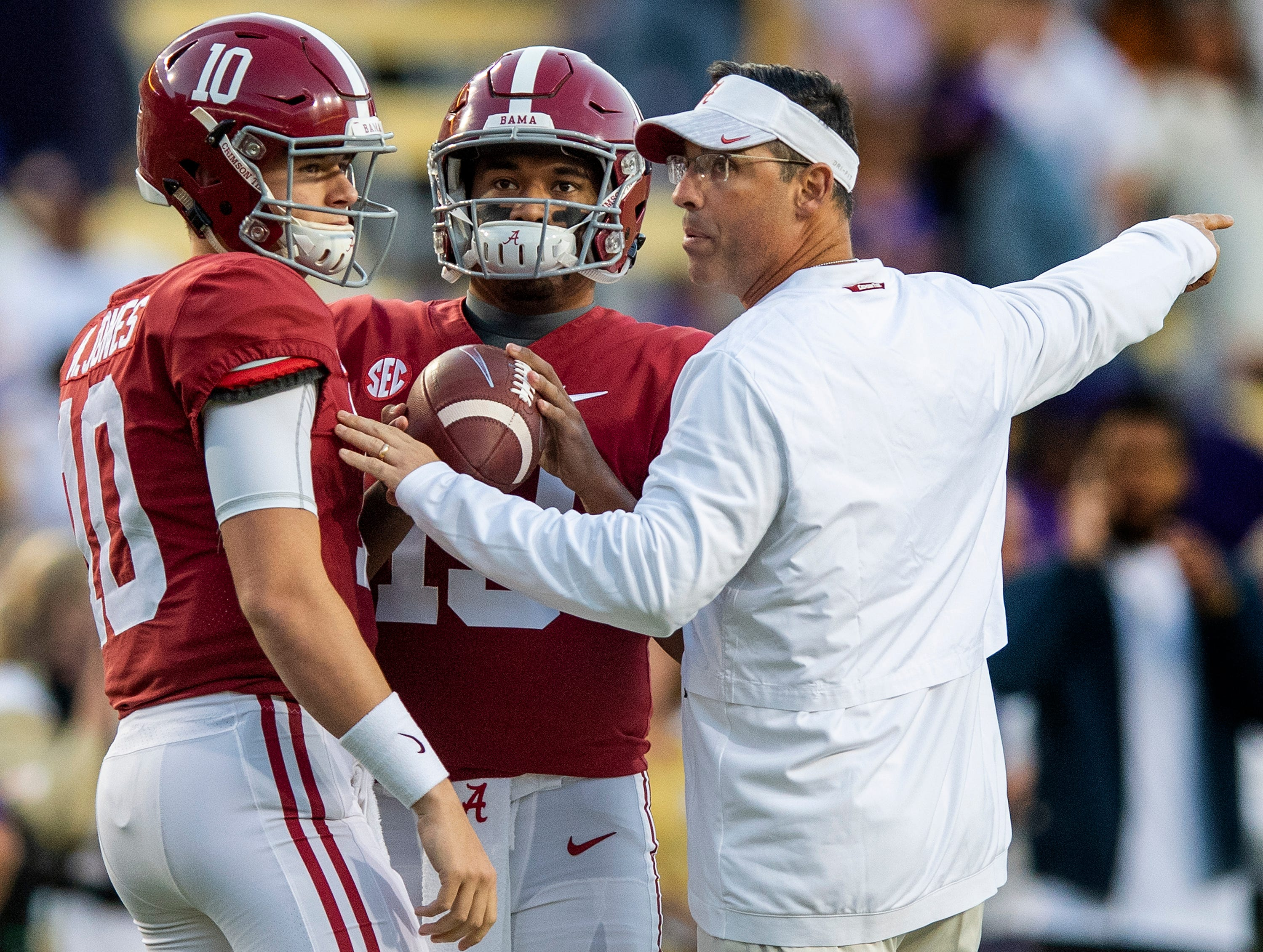 Alabama quarterback Tua Tagovailoa (13), quarterback Mac Jones (10) and quarterbacks coach Dan Enos before the LSU game at Tiger Stadium in Baton Rouge, La., on Saturday November 3, 2018.