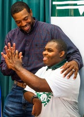 Joseph Bradley, right, high fives his riding coach Ralph Chishon, from the Therapeutic Recreation Center, on Thursday November 8, 2018 at Jeff Davis High School in Montgomery, Ala. Joseph has been chosen to be on the Special Olympics equestrian team competing at the Special Olympics World Games in Abu Dhabi next year.