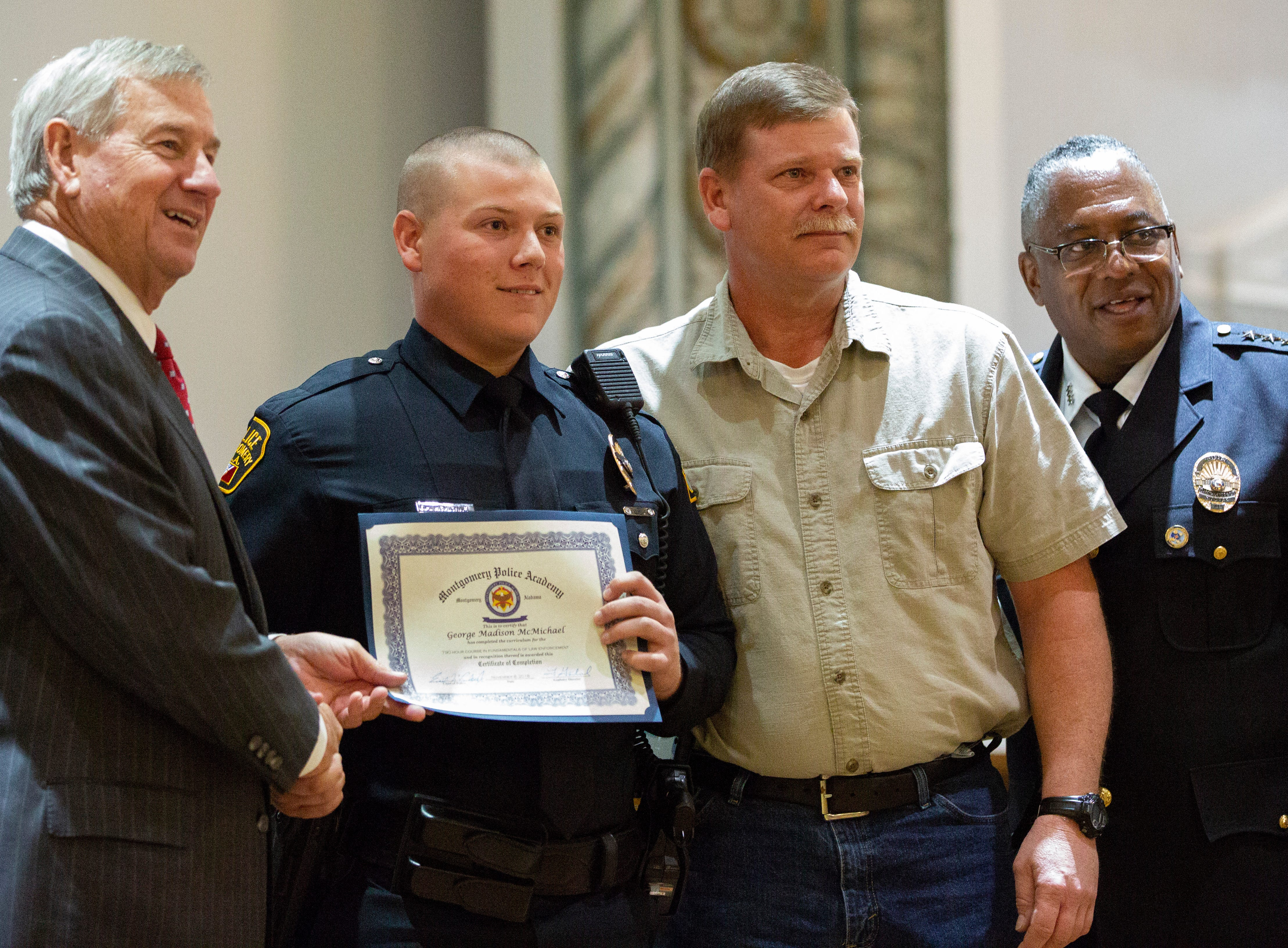 Montgomery police officer George McMichael poses for a photo after graduating from the academy.