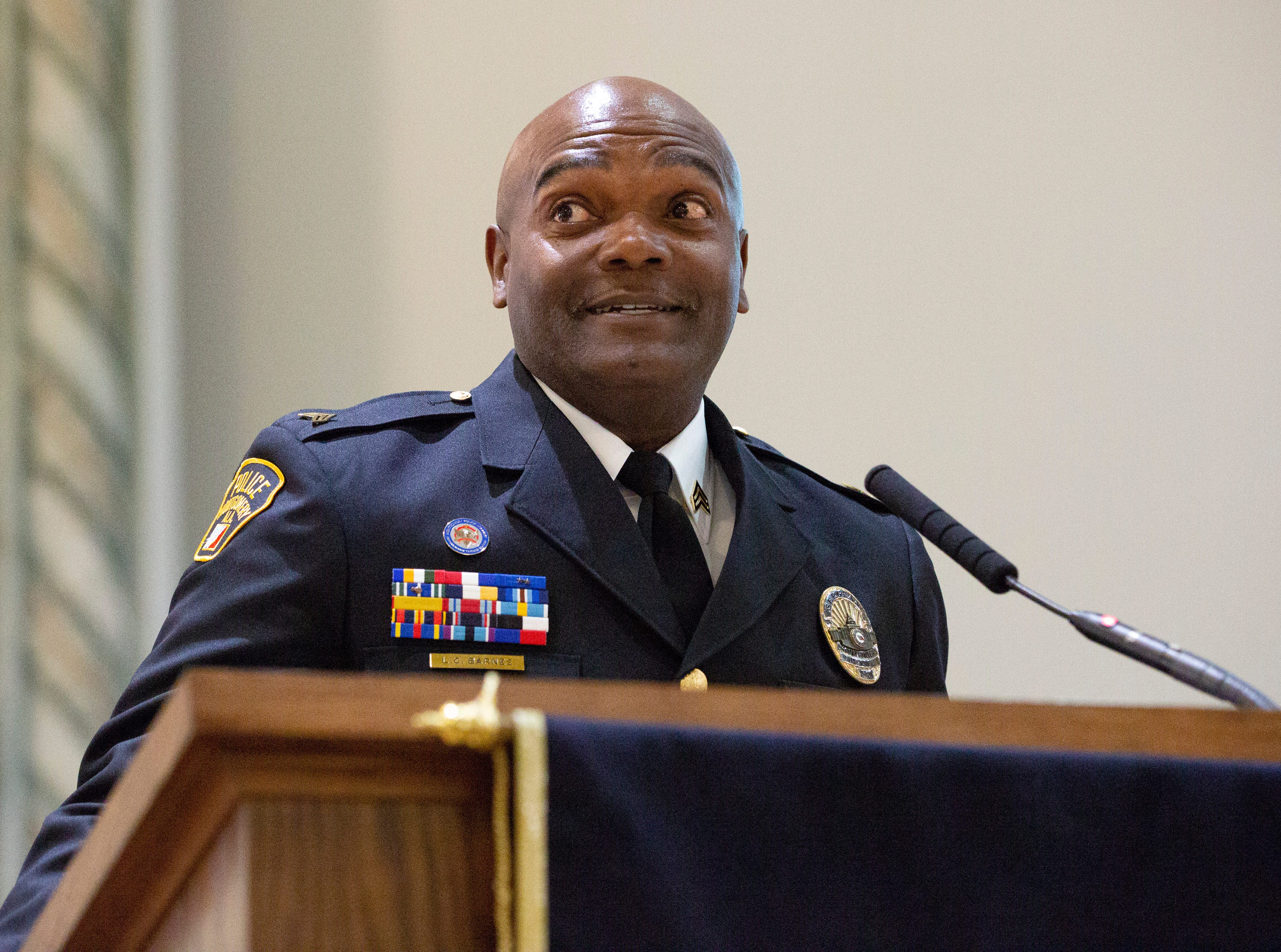 Montgomery police Sgt. L.C. Barnes speaks during a graduation ceremony for new police officers.