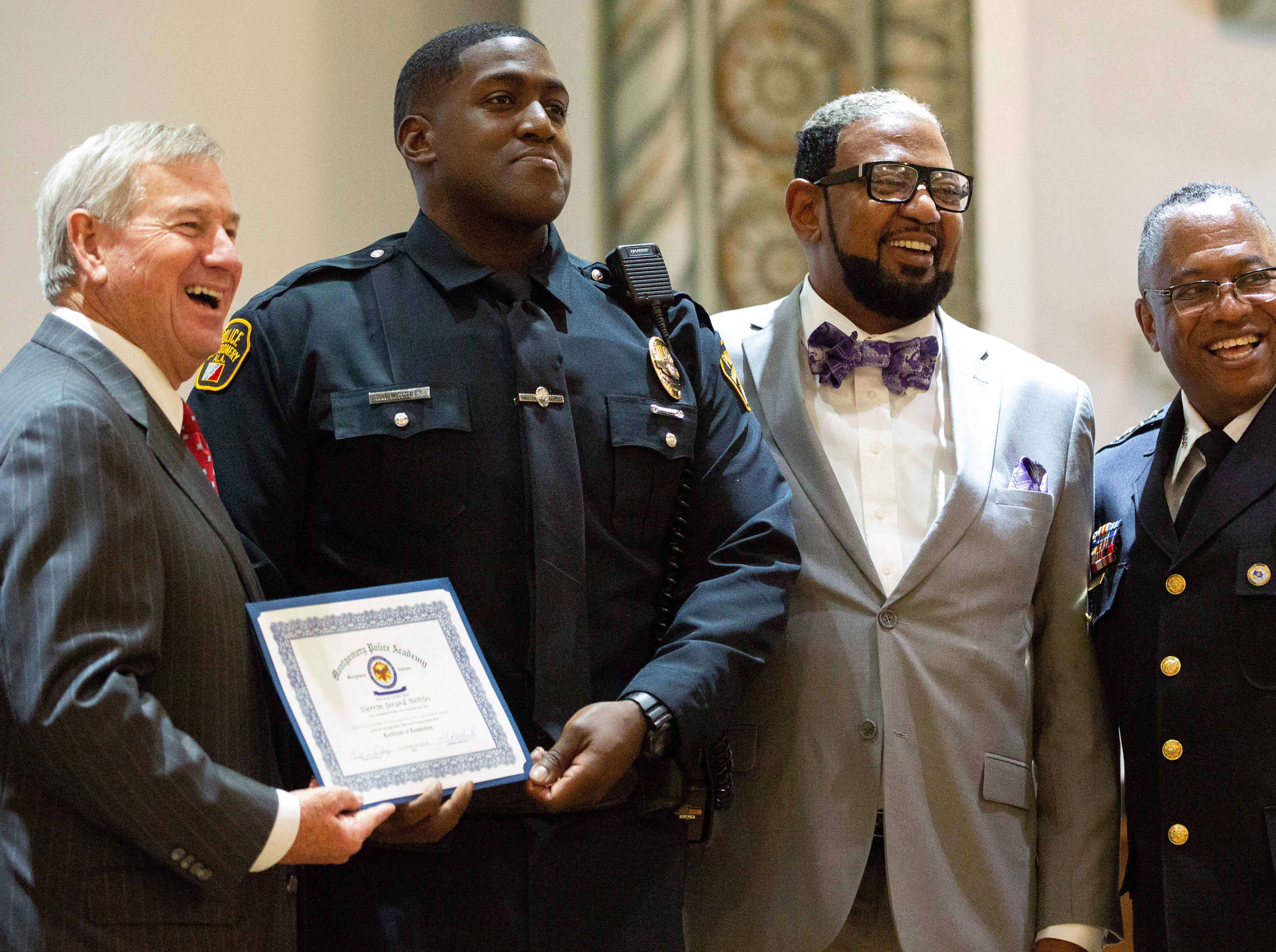 Montgomery police officer Derrin Nettles poses for a photo after graduating from the academy.