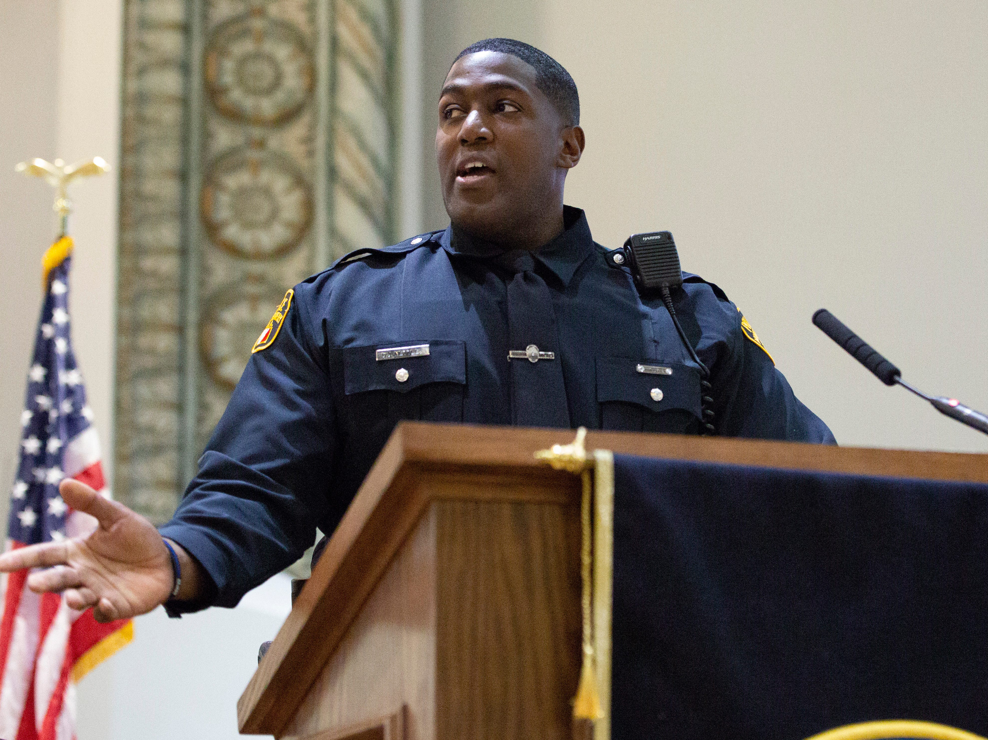 Montgomery police officer Derrin Nettles, president of his graduating class, thanks his instructors during a ceremony at City Hall.