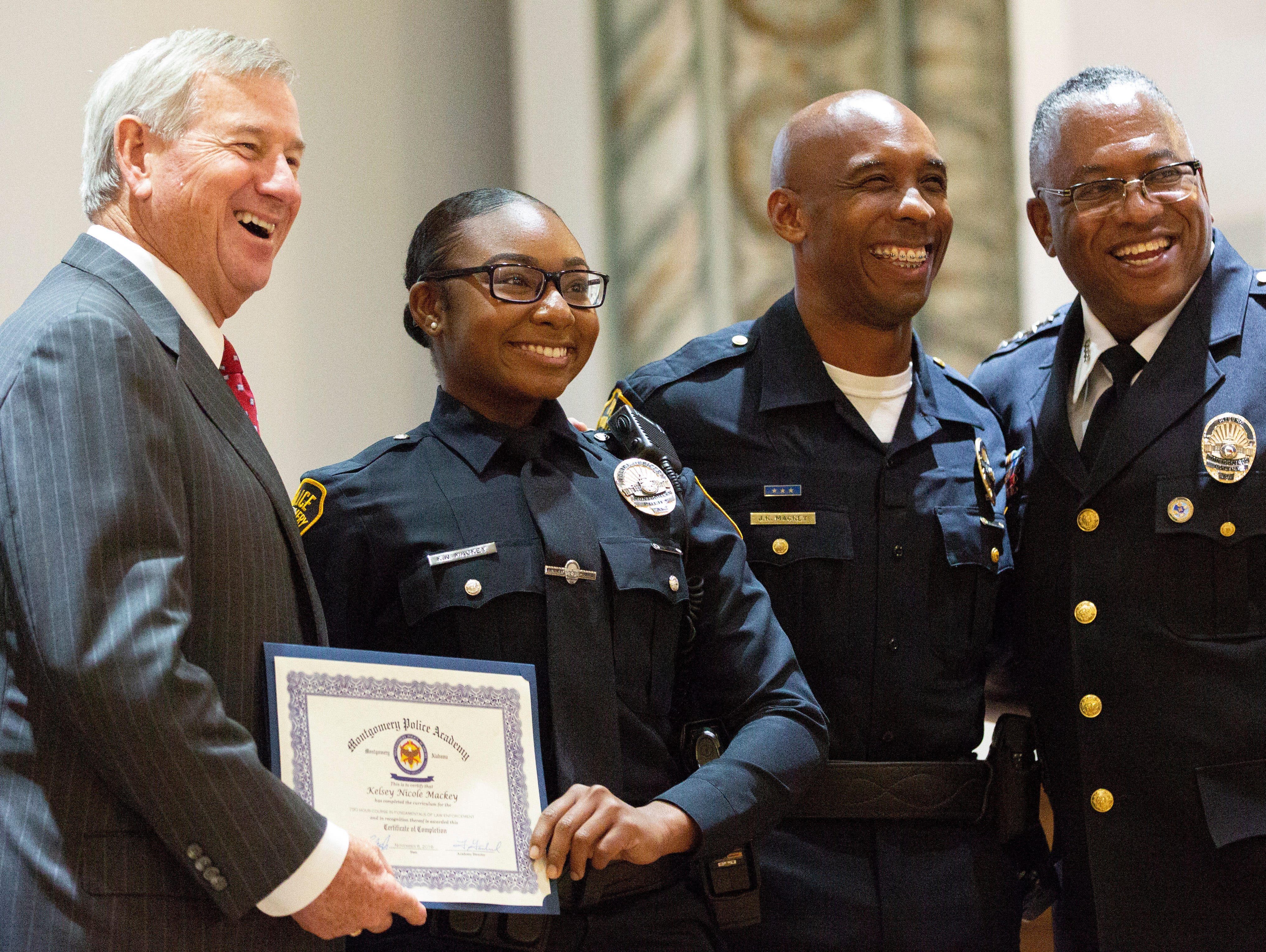 Montgomery police officer Kelsey Mackey poses for a photo after graduating from the academy.