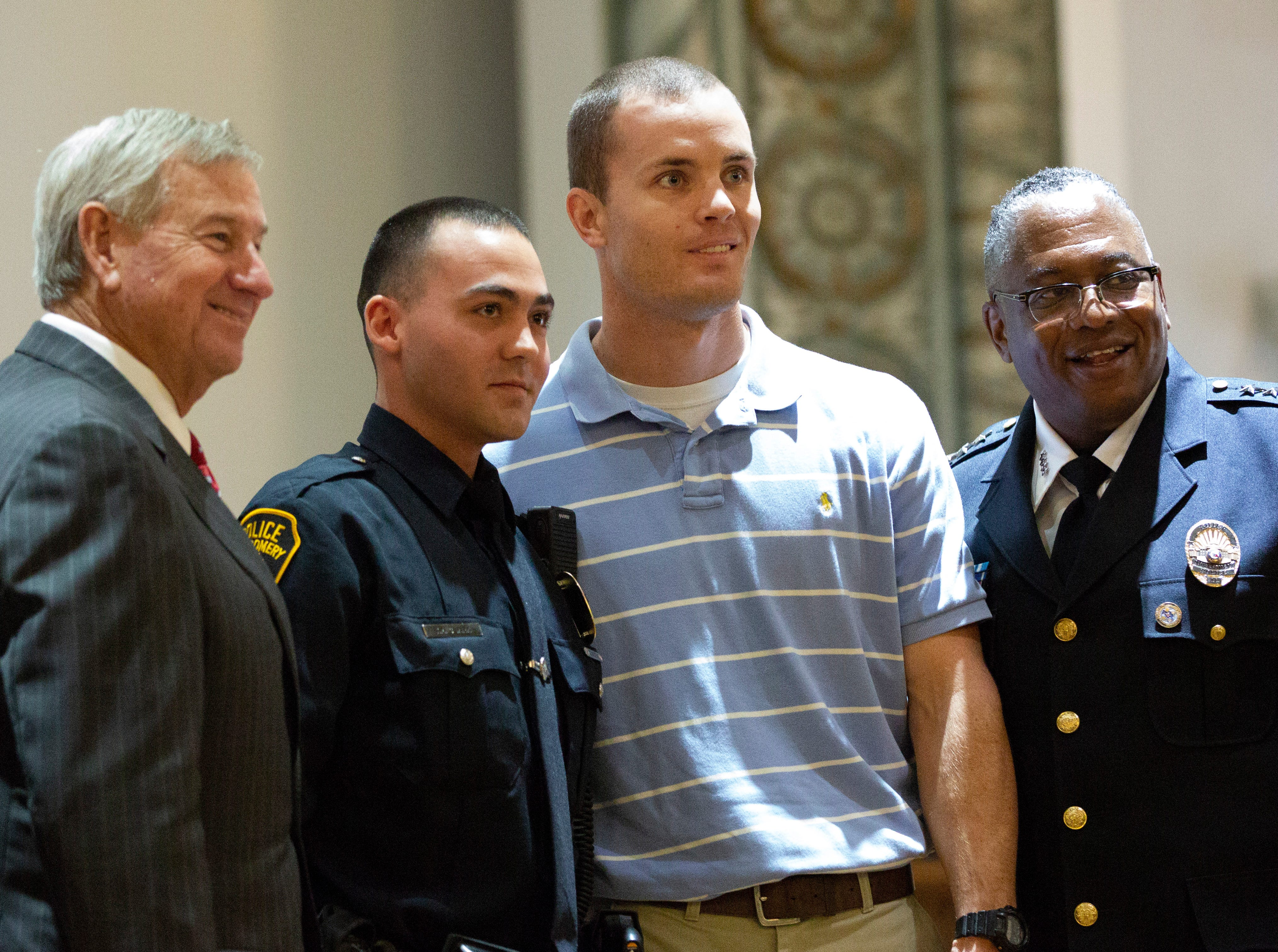 Montgomery police officer Taylor Clark poses for a photo after graduating from the academy.