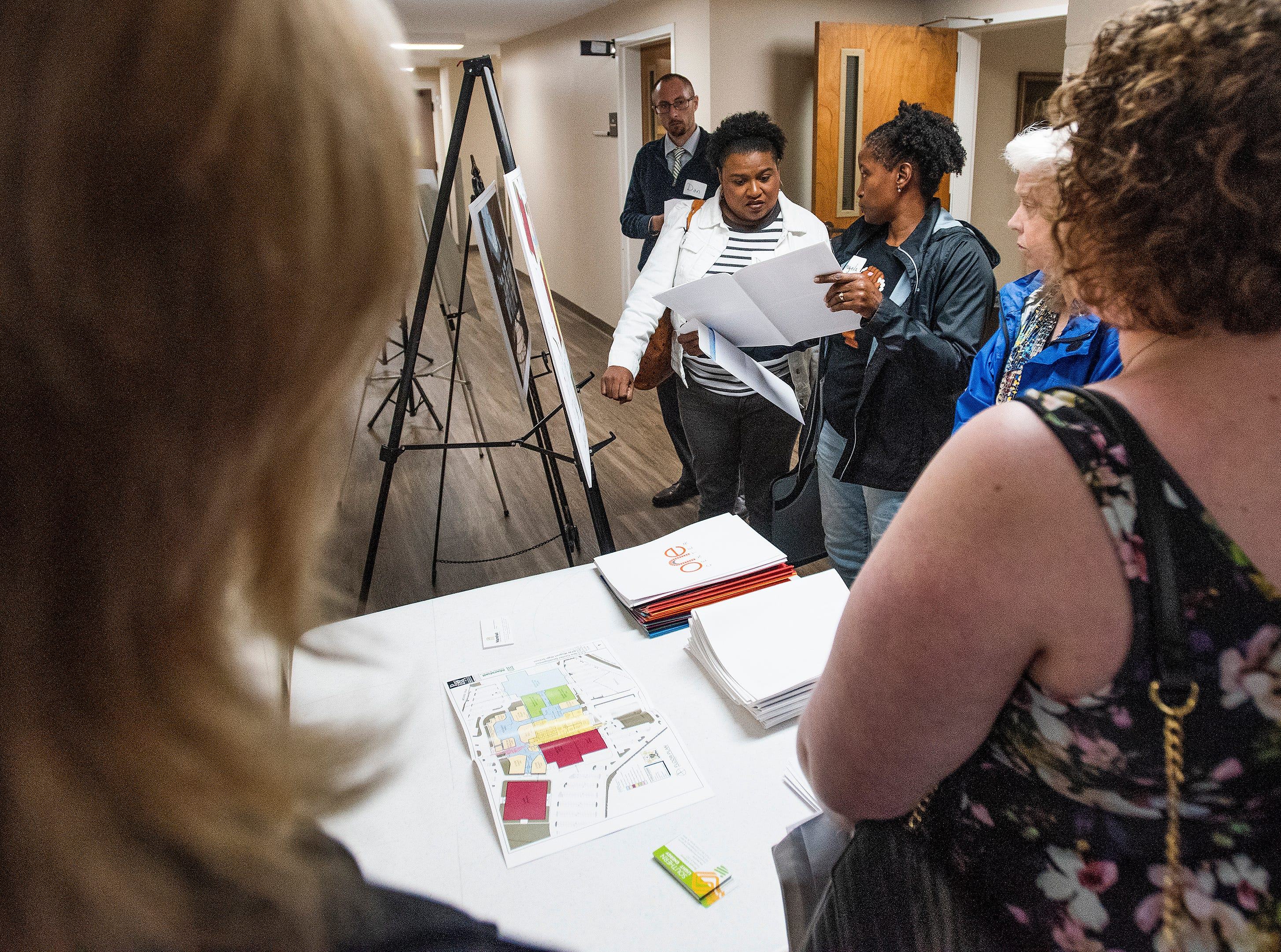 People look at proposed sites during a Community Charrette held to discuss BTW Magnet School plans on Thursday November 8, 2018 at Aldersgate United Methodist Church in Montgomery, Ala.