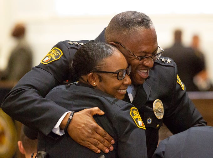 Montgomery police Chief Ernest Finley shares a hug with newly graduated police officer Kelsey Mackey.