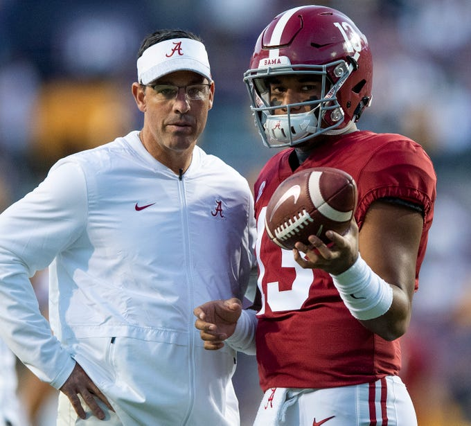 Alabama quarterback Tua Tagovailoa (13)] talks with Alabama quarterbacks coach Dan Enos before the LSU game at Tiger Stadium in Baton Rouge, La., on Saturday November 3, 2018.
