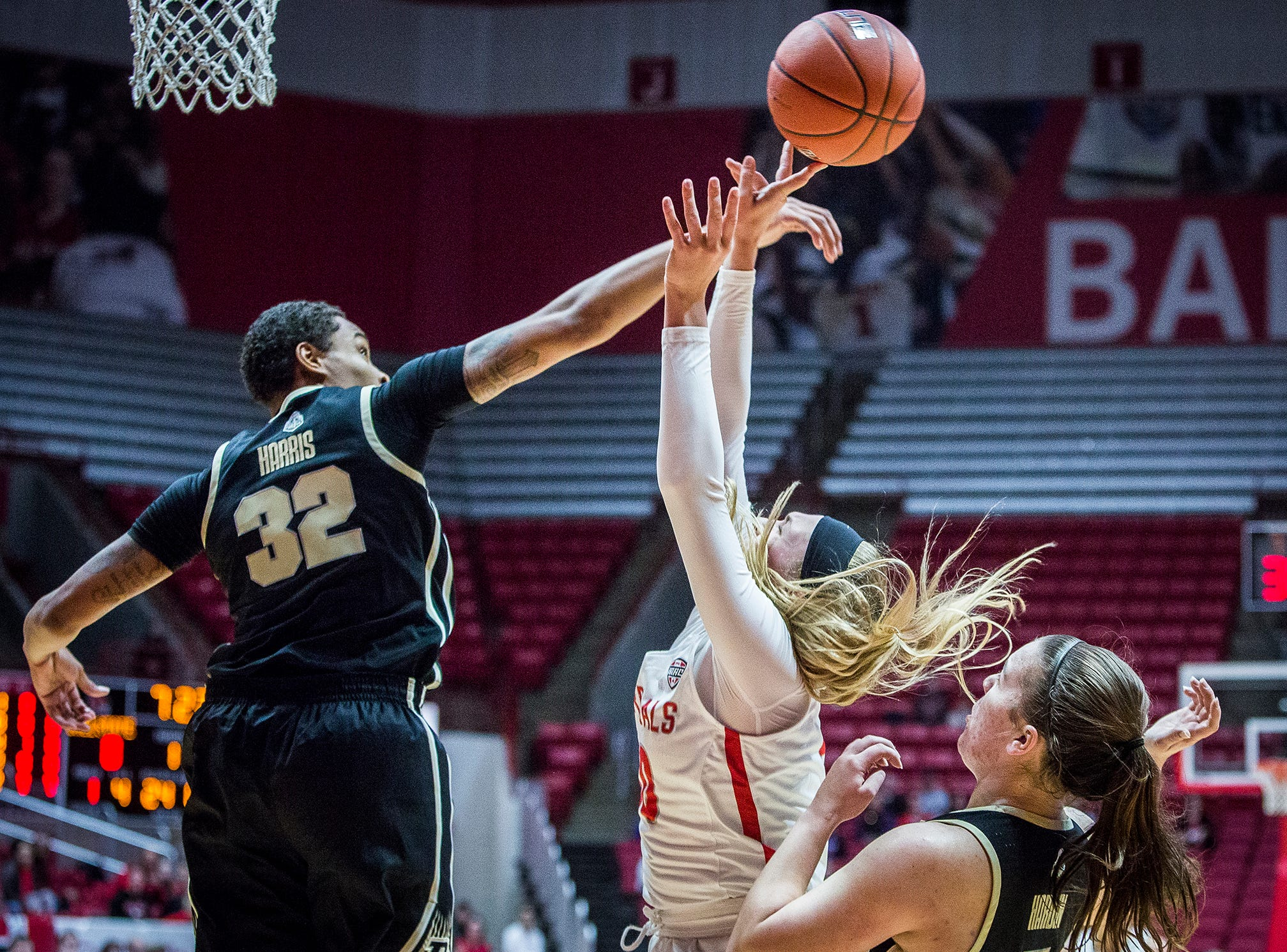 Purdue's Ae'Rianna Harris blocks a shot from Ball State's Anna Clephane during their game at Worthen Arena Wednesday, Nov. 7, 2018.