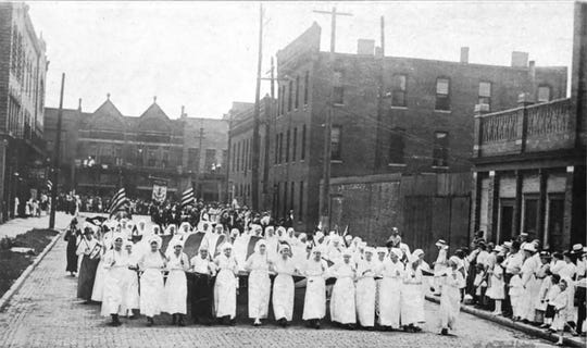 Delaware County War Mothers march in a parade in Muncie in this historic photo.