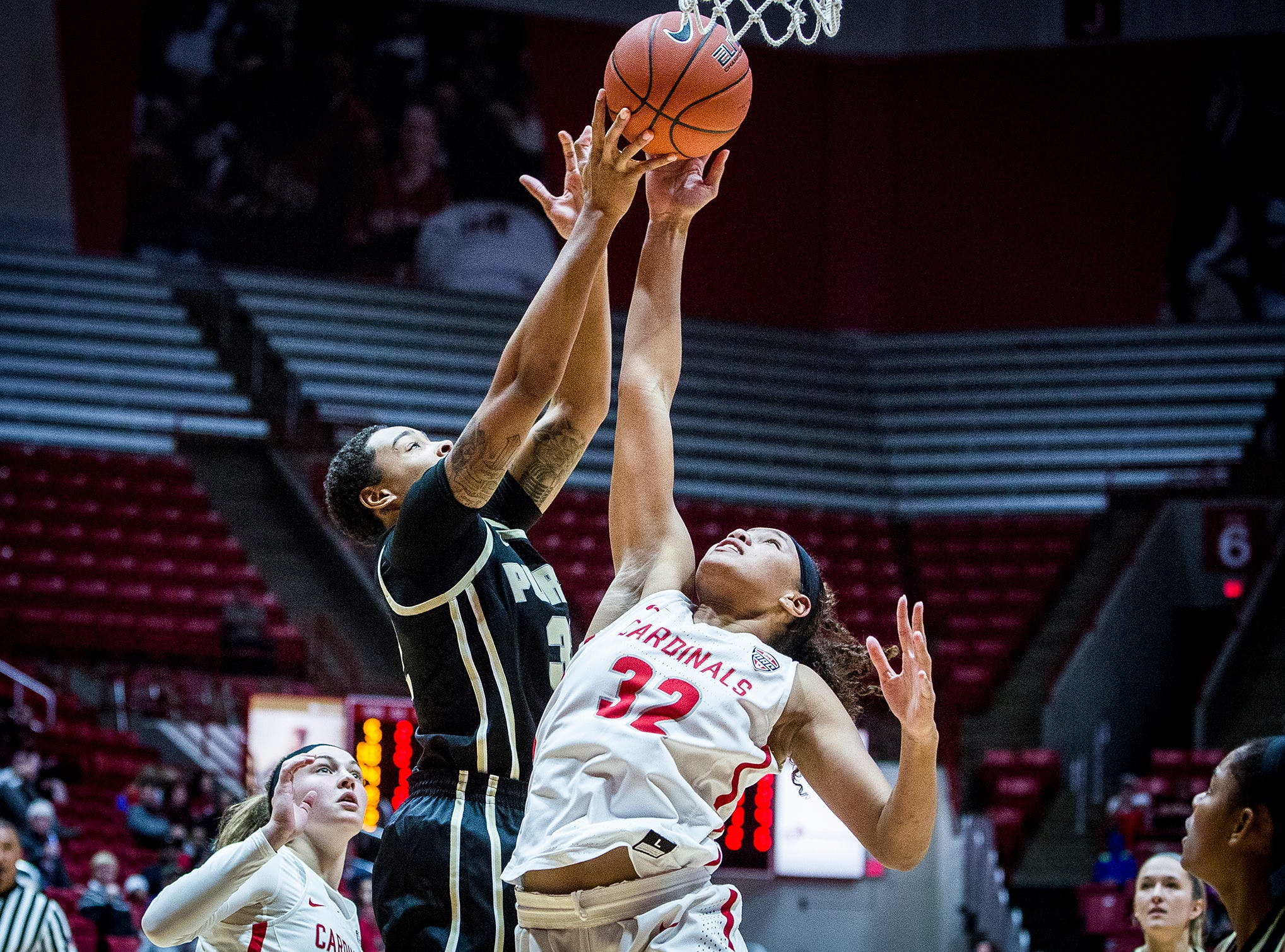 Purdue's Ae'Rianna Harris grabs a rebound past Ball State's defense during their game at Worthen Arena Wednesday, Nov. 7, 2018.