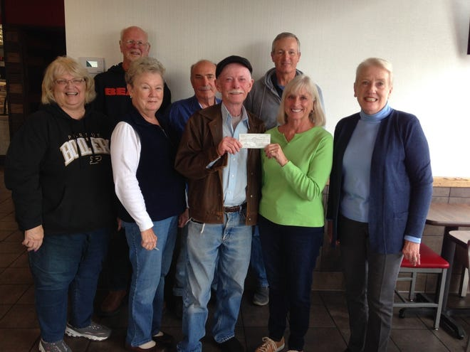 Pictured are (front row, from left) Cheryl Zell, Candy Wilson, Ed Walters for the Winchester Alumni Association presenting a check to Literacy Coalition Treasurer Peggy Moore; Pat Knasinski, Winchester Alumni Association President; and back Row, Randolph County Literacy Coalition President Larry Hall, Dick Webster, and John Moore.