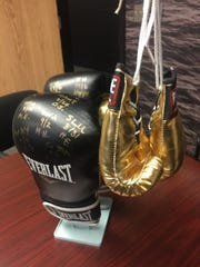 Vanderbilt women's soccer coach Darren Ambrose has boxing gloves on his desk, signed by players who show the most fight in a game.