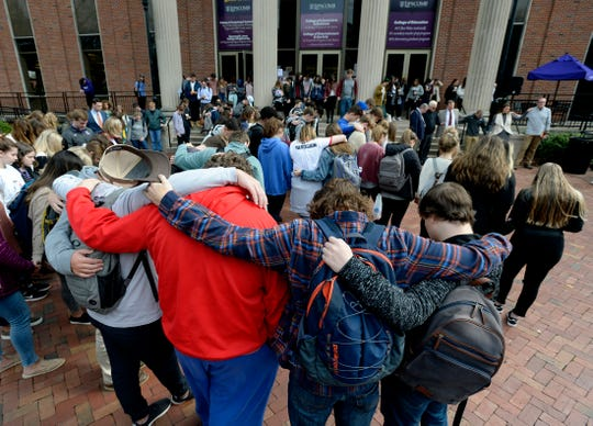 Students spend a moment in silence during a  prayer service at Lipscomb University on Thursday. The event honored the 12 victims of a mass shooting at a bar Wednesday night in Southern California. College students from Pepperdine University were in the bar at the time of the shooting. Both Pepperdine and Lipscomb are affiliated with the Church of Christ.