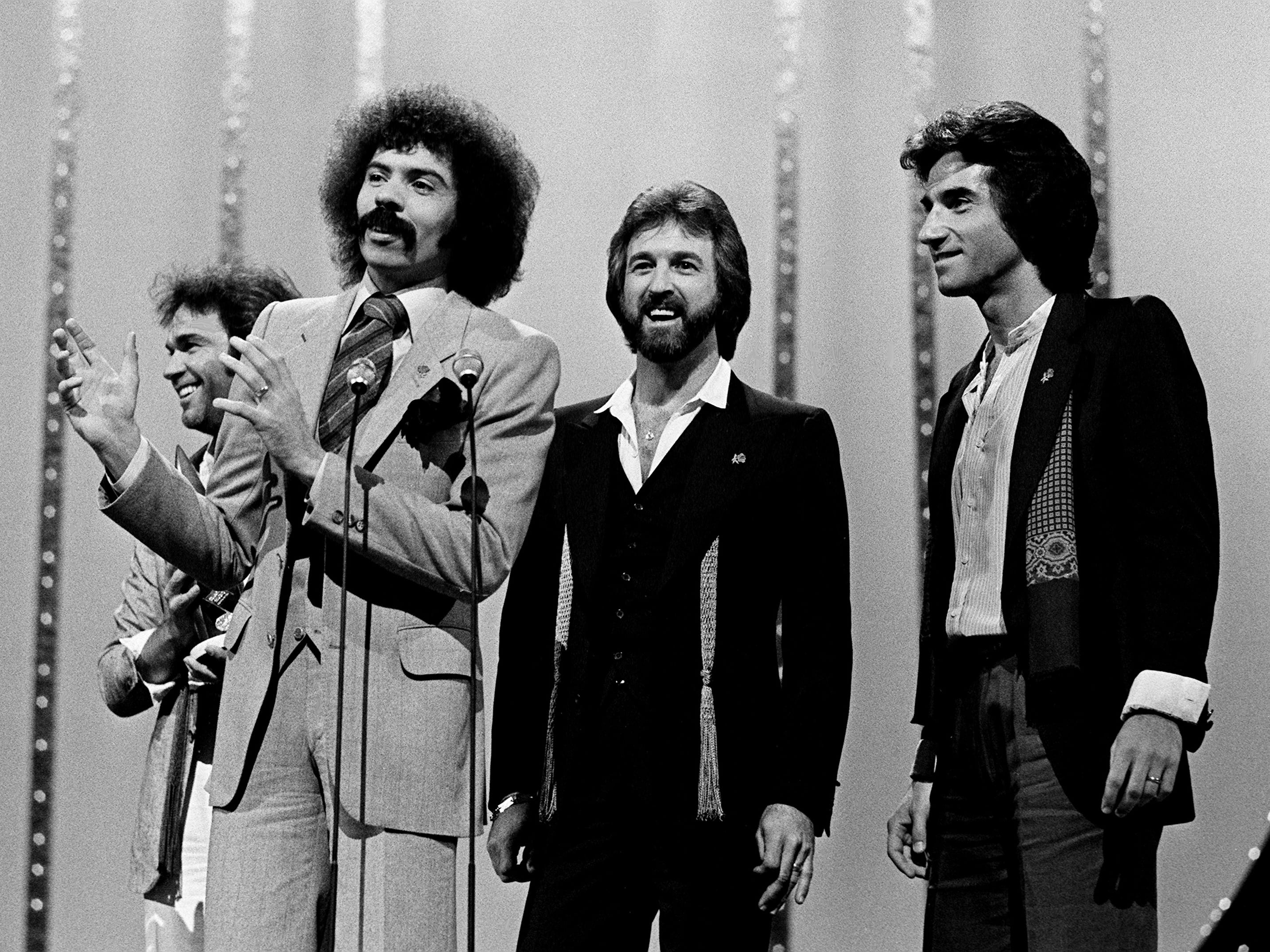 Joe Bonsall, second from left, speaks for the Oak Ridge Boys after they won the Vocal Group of the Year award during the 12th annual CMA Awards show Oct. 9, 1978. The Oak Ridge Boys, with members William Lee Golden, left, Duane Allen and Richard Sterban, were a gospel group until two years ago and won the award, which had been the property of the Statler Brothers for the past six years. They also won the Instrumental Group of the Year award.