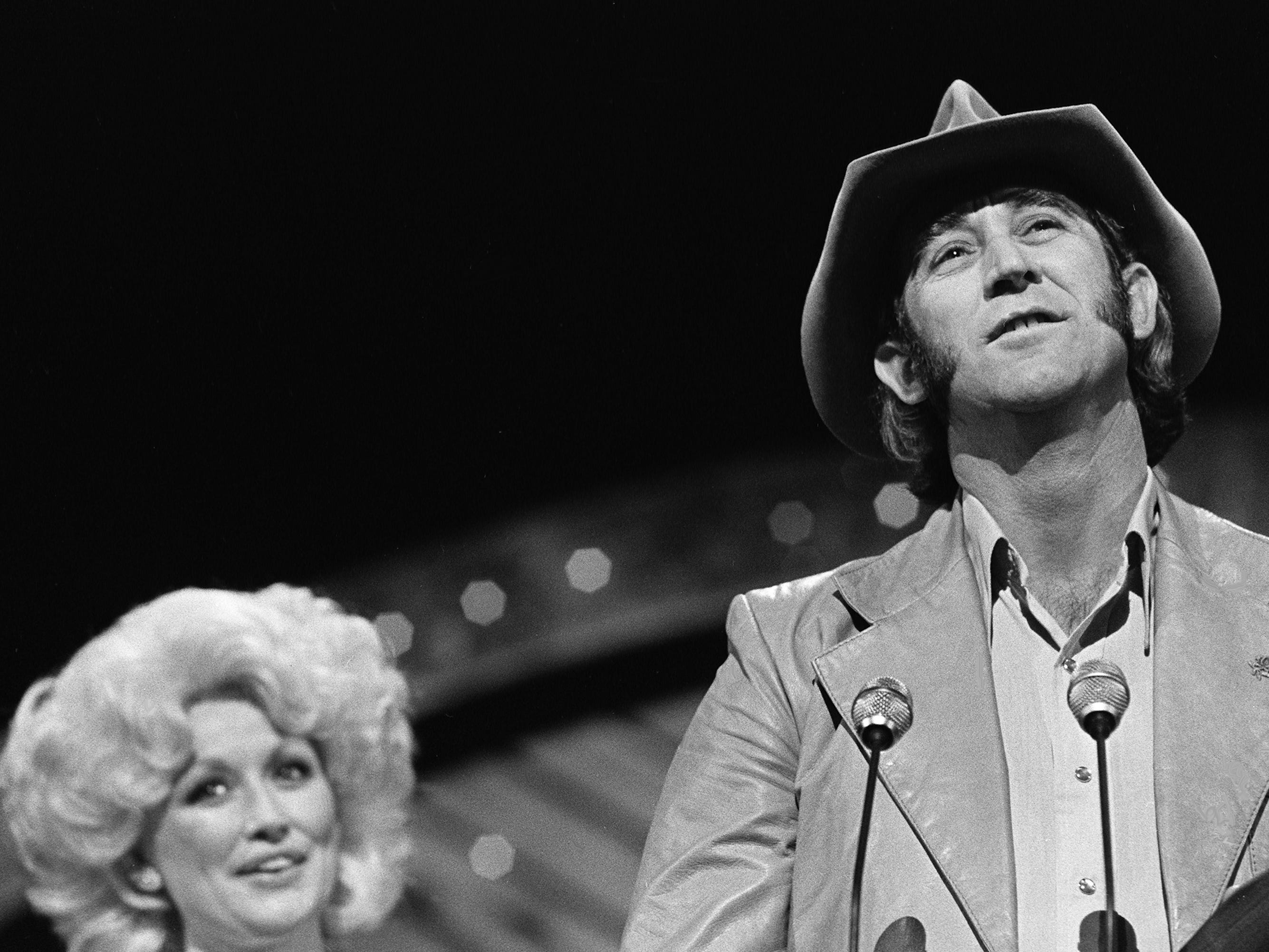 Don Williams accepts the Male Vocalist of the Year award during the 12th annual CMA Awards show Oct. 9, 1978. Looking on is presenter Dolly Parton.