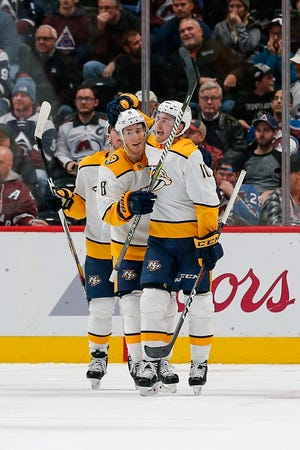 Nov 7, 2018; Denver, CO, USA; Nashville Predators center Kyle Turris (8) celebrates the goal of center Colton Sissons (10) in the second period against the Colorado Avalanche at the Pepsi Center. Mandatory Credit: Isaiah J. Downing-USA TODAY Sports