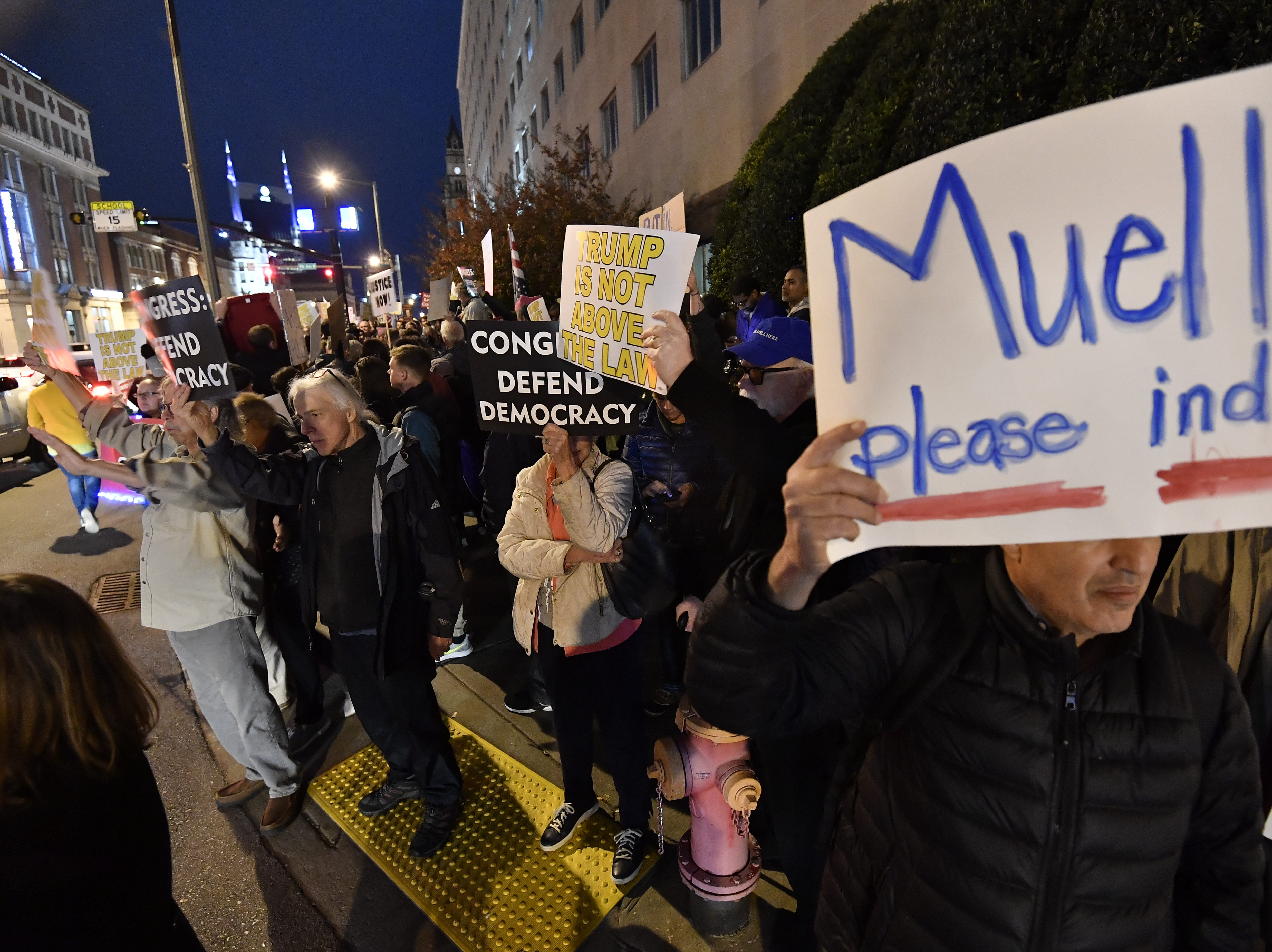 Demonstrators protest against President Donald Trump along Broadway in downtown Nashville on Thursday, Nov. 8, 2018.