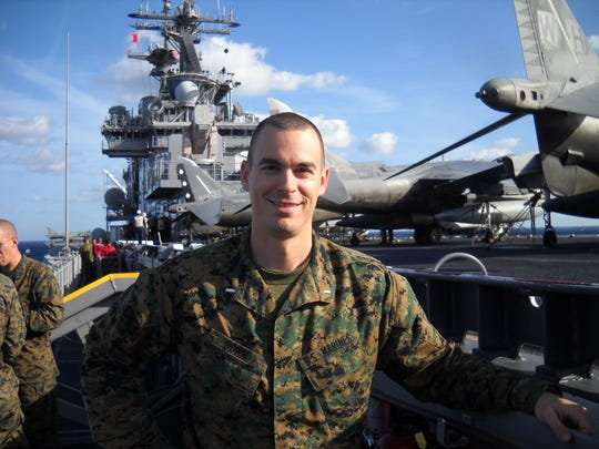 In 2012, after returning from Afghanistan, Marine First Lt. Aaron Dorn stands aboard the USS Kearsarge amphibious assault ship for military training exercises in Virginia.