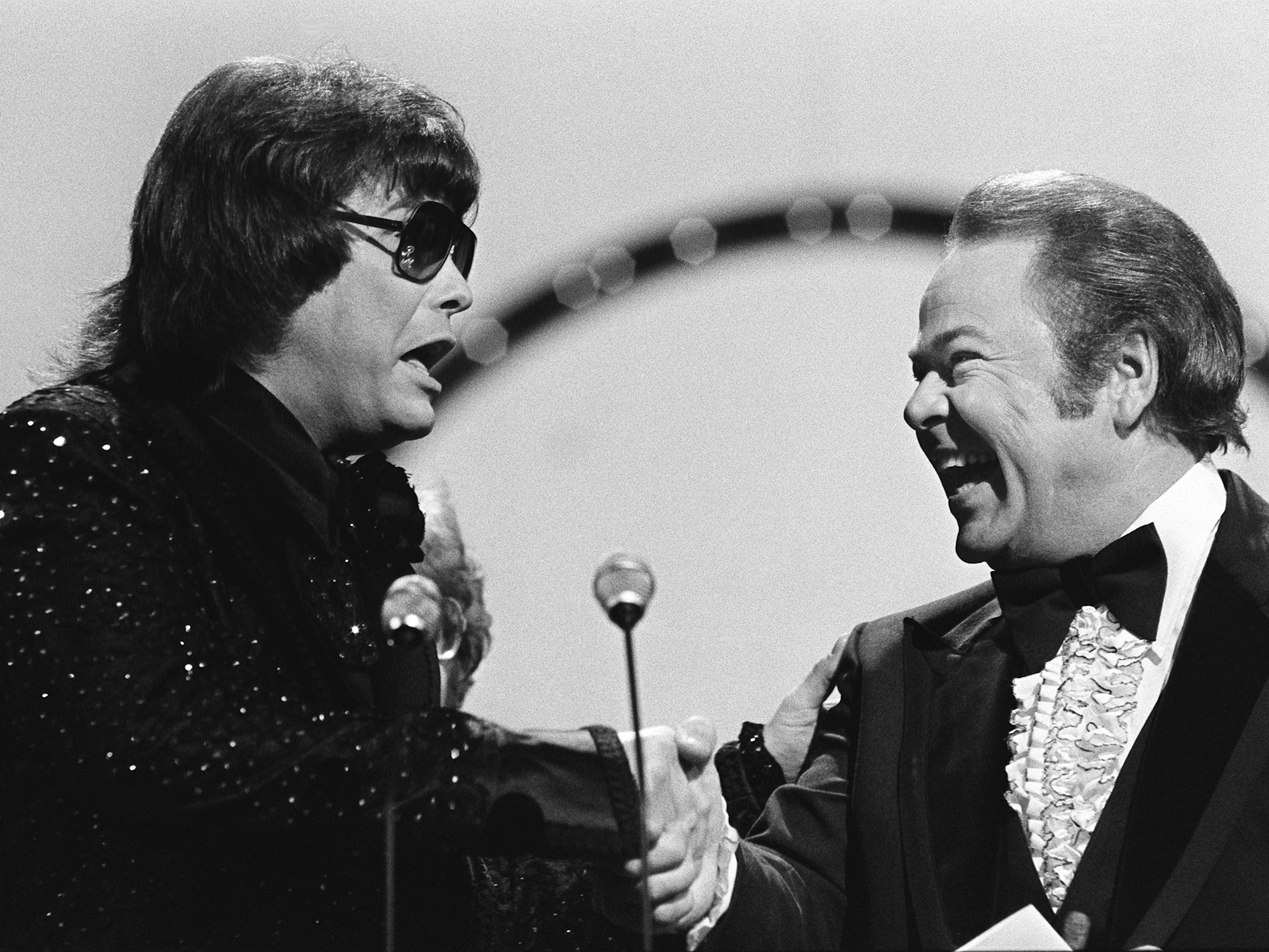 "Ronnie Milsap, left, is congratulated by presenter Roy Clark after winning the Album of the Year award during the 12th annual CMA Awards show Oct. 9, 1978. Milsap, winner of the honor for the second year in a row, won with ""It Was Almost Like a Song."""