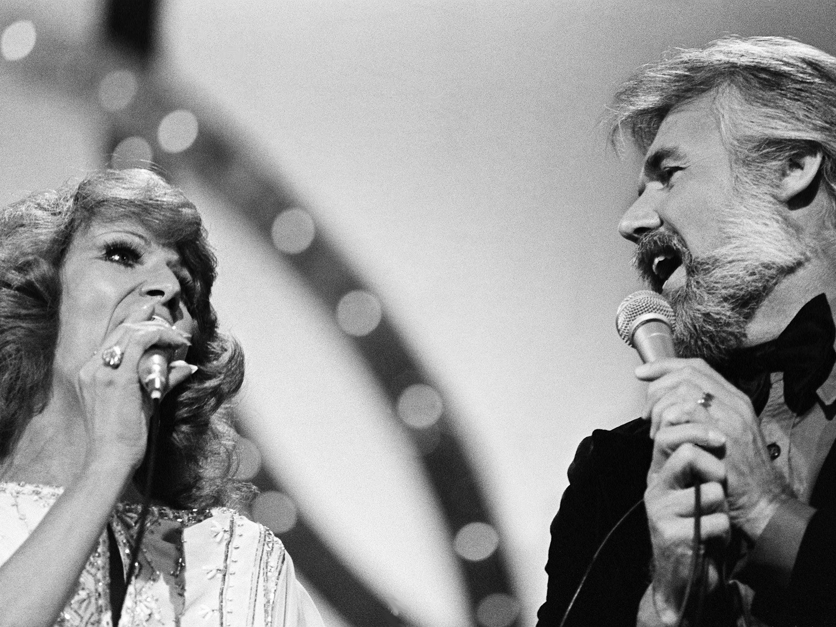 Dottie West and Kenny Rogers perform together during the 12th annual CMA Awards show at the Grand Ole Opry House on Oct. 9, 1978.