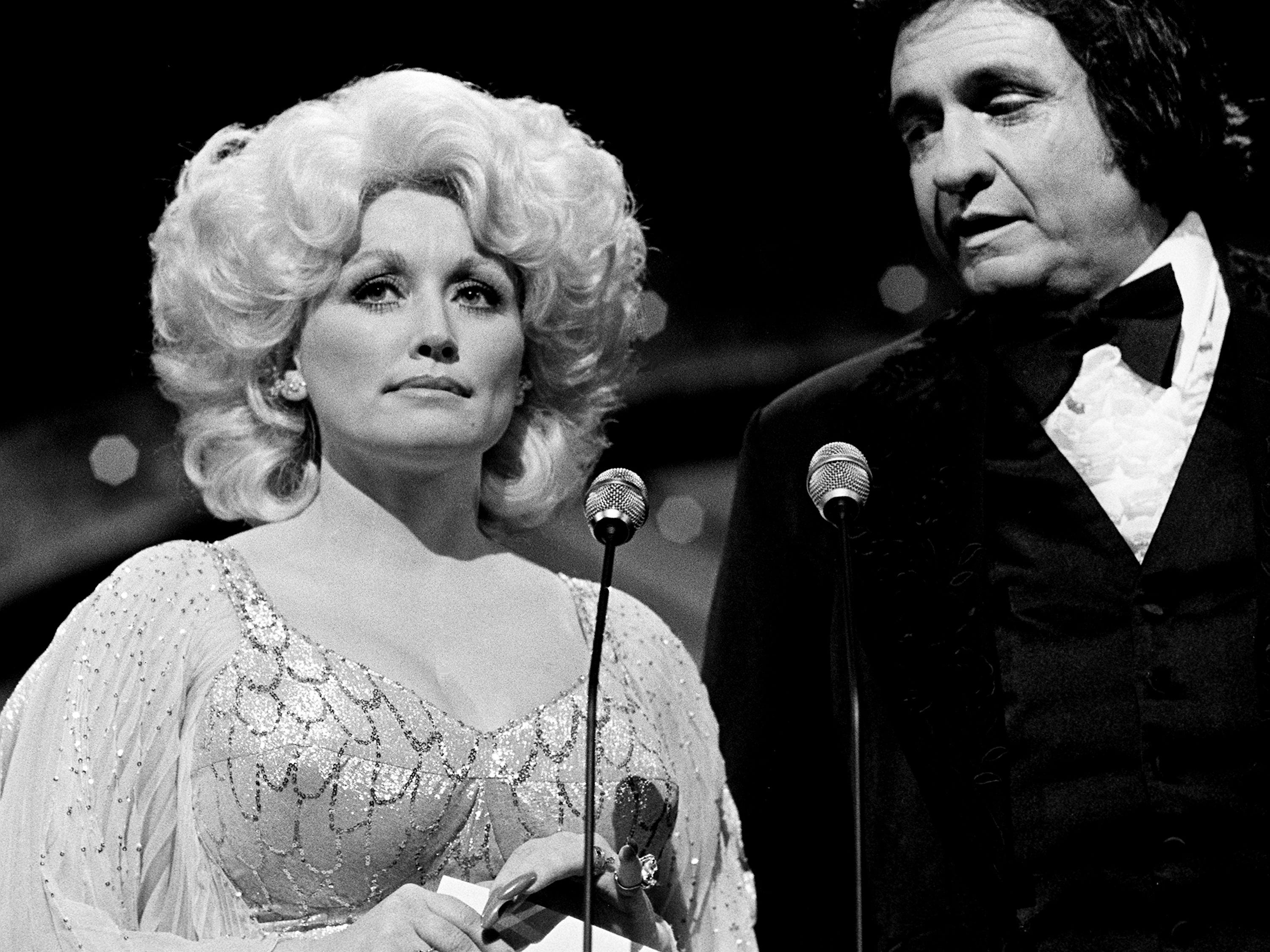 Dolly Parton and host Johnny Cash prepare to present the Male Vocalist of the Year award during the 12th annual CMA Awards show at the Grand Ole Opry House on Oct. 9, 1978.