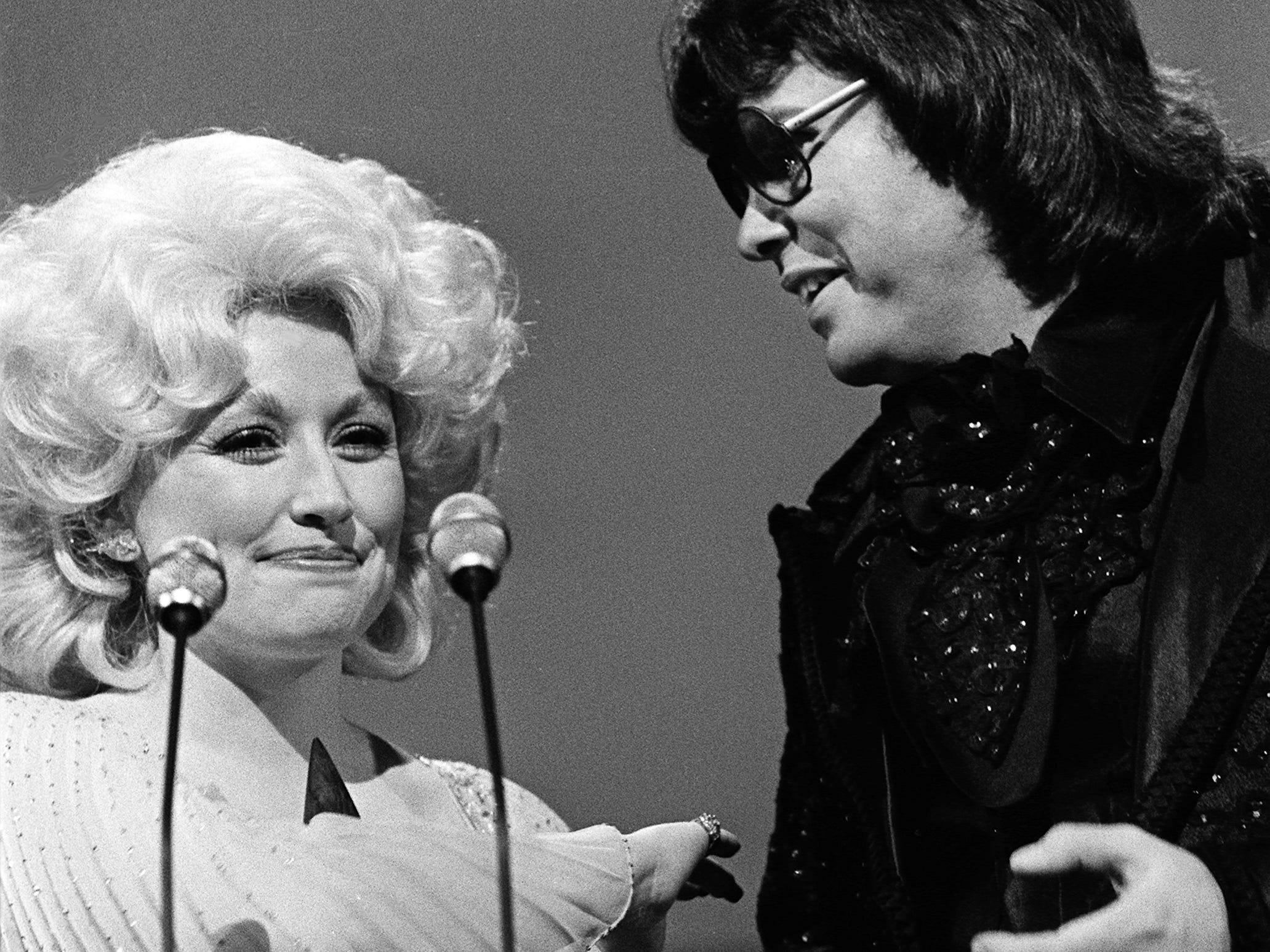 Dolly Parton is congratulated by presenter Ronnie Milsap after winning the Entertainer of the Year award during the 12th annual CMA Awards show Oct. 9, 1978. Parton won only one of the four awards she was nominated for, but it was the one she wanted most.