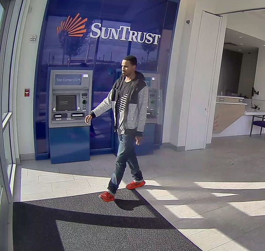 Brentwood police believe this is the same man who robbed the SunTrust Bank at 201 Franklin Road on Nov. 1. He is seen here leaving the bank on Oct. 30.