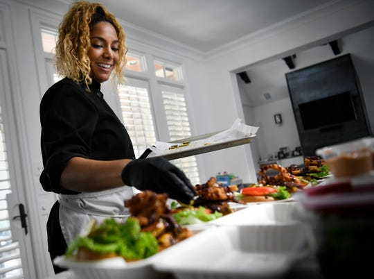 Chef Charity Morgan, wife of Titans linebacker Derrick Morgan prepares vegan meals for about a dozen of her husband's teammates  Friday, Nov. 2, 2018, in Nashville, Tenn.