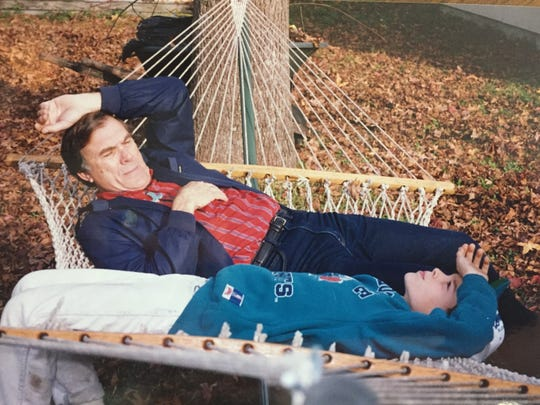 """Aaron Dorn shares a hammock with his grandfather, Larry """"Papa"""" Jackson, at Papa's house in North Charleston, S.C., in 1994."""
