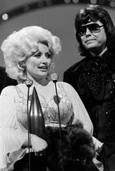 "Dolly Parton is presented the Entertainer of the Year award by Ronnie Milsap during the 12th annual CMA Awards show Oct. 9, 1978. The two recorded a new version of his hit ""Smoky Mountain Rain"" for the ""Ronnie Milap: The Duets"" album."