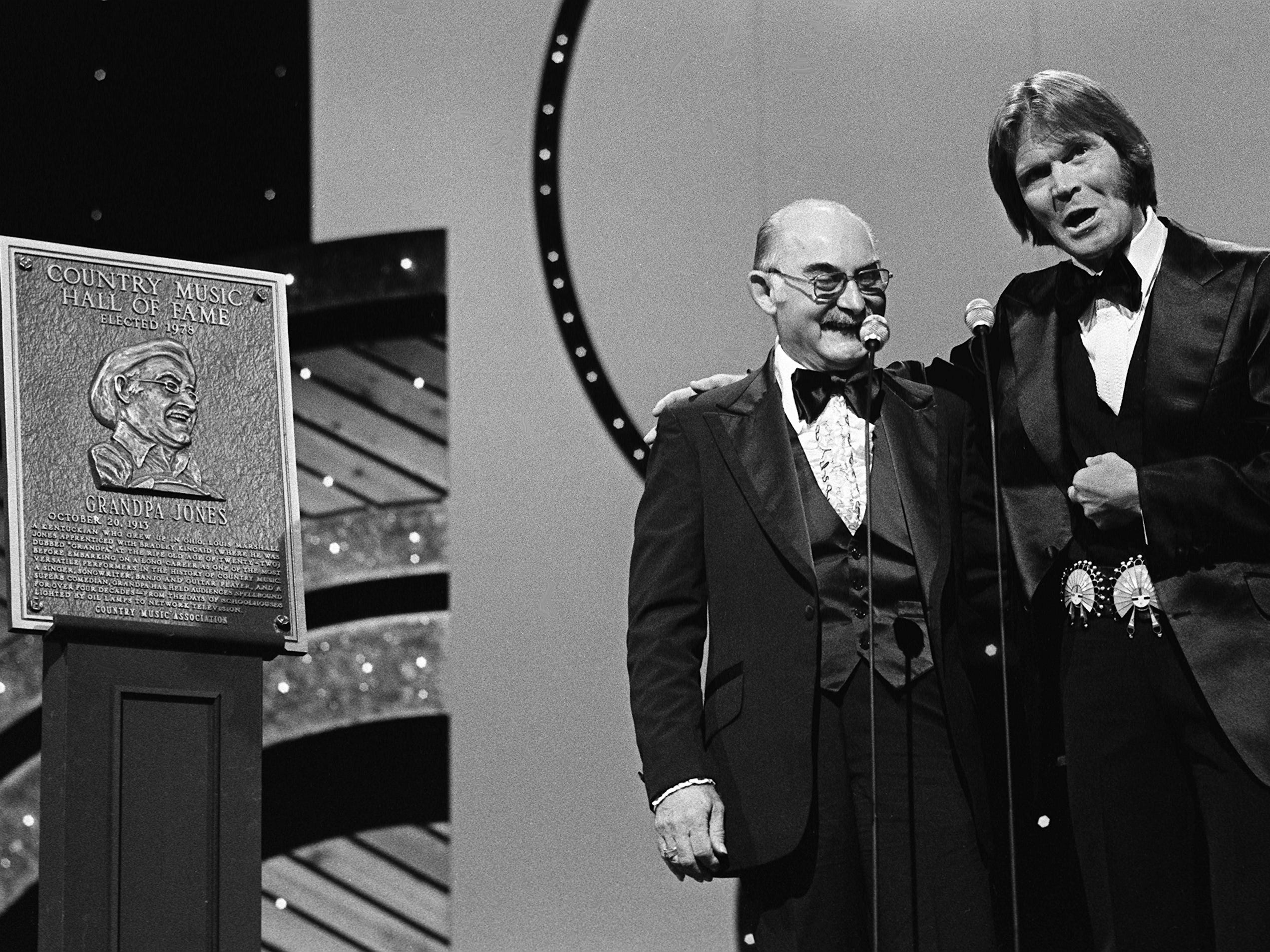 Glen Campbell, right, introduces longtime star Grandpa Jones as the 29th member of the Country Music Hall of Fame during the 12th annual CMA Awards show Oct. 9, 1978.